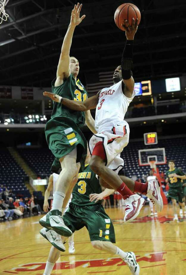 Fairfield's Derek Needham drives to the basket against Siena defender Owen Wignot in the first half of their MAAC conference matchup at the Webster Bank Arena in Bridgeport, Connecticut on Sunday, February 5, 2012. Photo: Brian A. Pounds / Connecticut Post