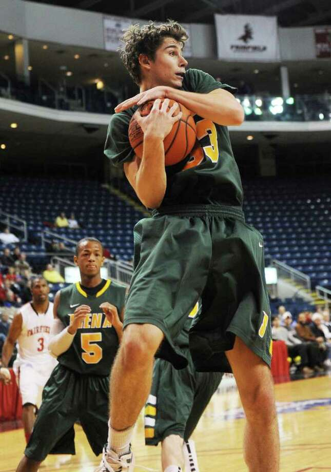 Siena's Rob Poole grabs a rebound in the first half of their MAAC conference matchup with Fairfield at the Webster Bank Arena in Bridgeport, Connecticut on Sunday, February 5, 2012. Photo: Brian A. Pounds / Connecticut Post