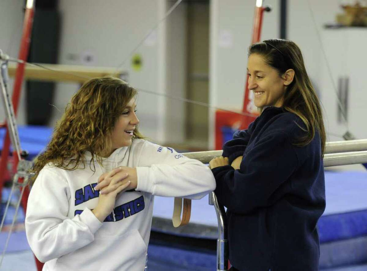 Assistant Coach Tiffany Hogben, left speaks with Head Coach Deb Smarro at the Saratoga YMCA on Old Gick Road in Saratoga Springs, N.Y. Dec. 30, 2011. ( Skip Dickstein/Times Union)