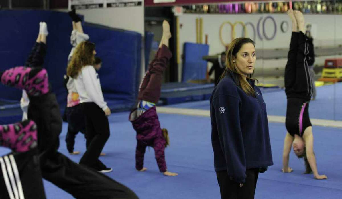Assistant Coach Tiffany Hogben,left and Head Coach Deb Smarro supervise gymnastics team workouts at the Saratoga YMCA on Old Gick Road in Saratoga Springs, N.Y. Dec. 30, 2011. ( Skip Dickstein/Times Union)