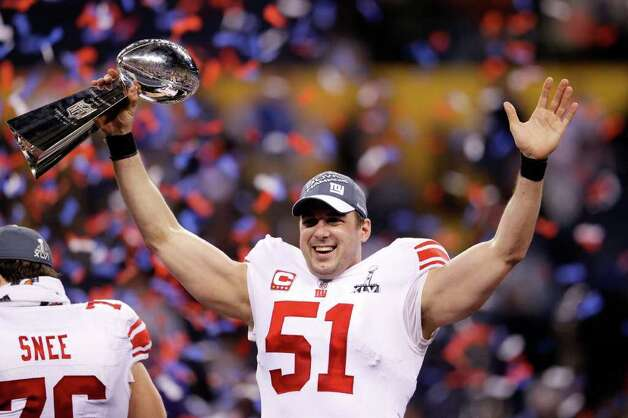 INDIANAPOLIS, IN - FEBRUARY 05:  Zak DeOssie #51 of the New York Giants poses with the Vince Lombardi Trophy after the Giants defeated the Patriots by a score of 21-17 in Super Bowl XLVI at Lucas Oil Stadium on February 5, 2012 in Indianapolis, Indiana. Photo: Rob Carr, Getty Images / 2012 Getty Images
