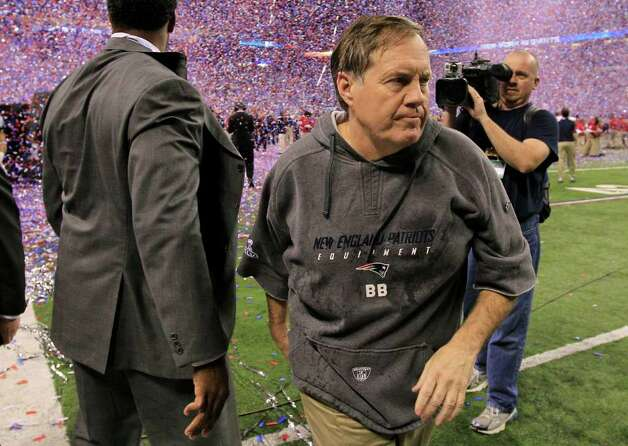 New England Patriots head coach Bill Belichick leaves the field after losing 21-17 to the New York Giants in the NFL Super Bowl XLVI football game, Sunday, Feb. 5, 2012, in Indianapolis. (AP Photo/Mark Humphrey) Photo: Mark Humphrey, Associated Press / AP