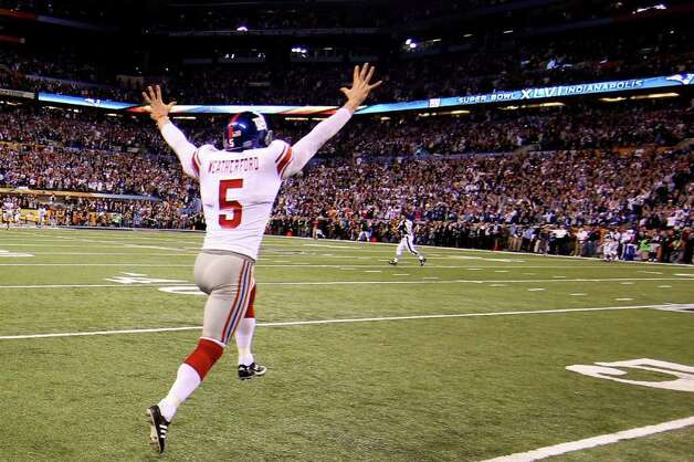INDIANAPOLIS, IN - FEBRUARY 05:  Steve Weatherford #5 of the New York Giants celebrates after the Giants defeated the New England Patriots 21-17 to win Super Bowl XLVI at Lucas Oil Stadium on February 5, 2012 in Indianapolis, Indiana. Photo: Ezra Shaw, Getty Images / 2012 Getty Images