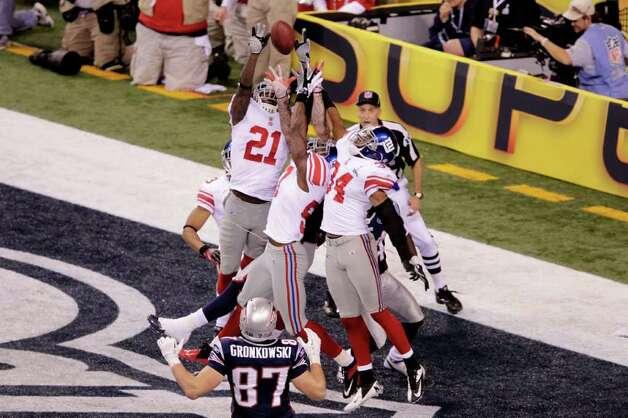 INDIANAPOLIS, IN - FEBRUARY 05:  Kenny Phillips #21 of the New York Giants blocks a pass intended for Aaron Hernandez #81 of the New England Patriots by Tom Brady #12 in the end zone in the fourth quarter during Super Bowl XLVI at Lucas Oil Stadium on February 5, 2012 in Indianapolis, Indiana. Photo: Joe Robbins, Getty Images / 2012 Getty Images