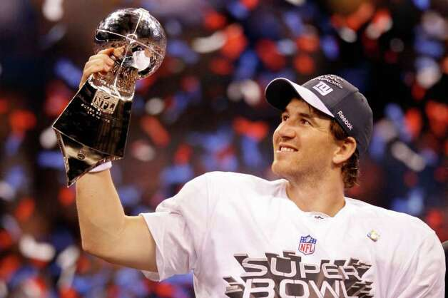 INDIANAPOLIS, IN - FEBRUARY 05:  Quarterback Eli Manning #10 of the New York Giants poses with the Vince Lombardi Trophy after the Giants defeated the Patriots by a score of 21-17 in Super Bowl XLVI at Lucas Oil Stadium on February 5, 2012 in Indianapolis, Indiana. Photo: Rob Carr, Getty Images / 2012 Getty Images