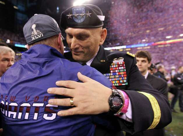 INDIANAPOLIS, IN - FEBRUARY 05:  Head coach Tom Coughlin of the New York Giants hugs U.S. Army Chief of Staff Gen. Ray Odierno after defeating the New England Patriots in Super Bowl XLVI at Lucas Oil Stadium on February 5, 2012 in Indianapolis, Indiana. The New York Giants defeated the New England Patriots 21-17. Photo: Jamie Squire, Getty Images / 2012 Getty Images