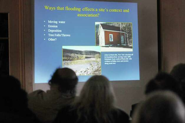 Visitors look at the screen as New York State archaeologist Christina Rieth gives a talk on the impact of Tropical Storm Irene on Schoharie Valley?s archaeological history at the Thacher Nature Center on Sunday, Feb. 5, 2012 in Voorheesville, NY.  (Paul Buckowski / Times Union) Photo: Paul Buckowski