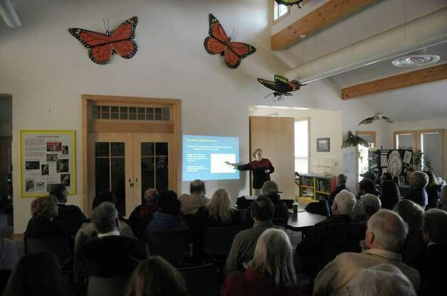 New York State archaeologist Christina Rieth, background right,  gives a talk on the impact of Tropical Storm Irene on Schoharie Valley?s archaeological history at the Thacher Nature Center on Sunday, Feb. 5, 2012 in Voorheesville, NY.  (Paul Buckowski / Times Union) Photo: Paul Buckowski