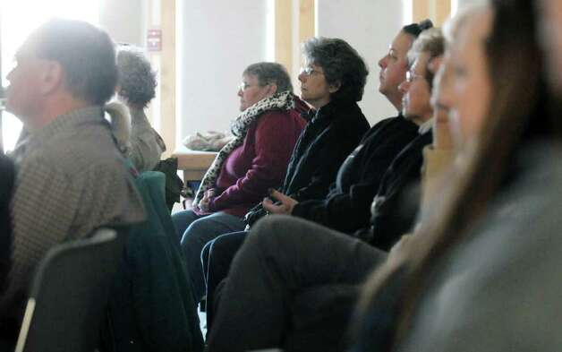 Visitors listen as New York State archaeologist Christina Rieth gives a talk on the impact of Tropical Storm Irene on Schoharie Valley?s archaeological history at the Thacher Nature Center on Sunday, Feb. 5, 2012 in Voorheesville, NY.  (Paul Buckowski / Times Union) Photo: Paul Buckowski