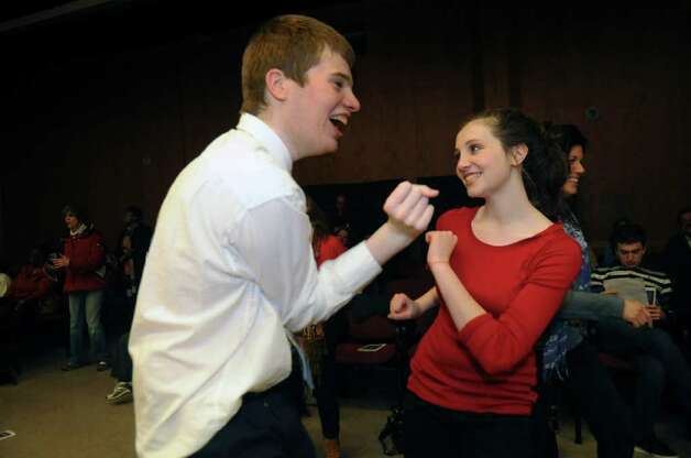 Karl Arezzini, 21, of Greenwich, dances with his sister Rose, 16, at the Abilis Family Rock Show for young people of all abilities at the Stamford Jewish Community Center Sunday, Feb. 5, 2012. Photo: Helen Neafsey / Greenwich Time