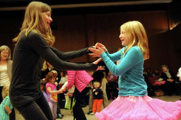 Gabi Freeda, 13, left, dances with Lucie Swan, 10, both of Stamford, at the Abilis Family Rock Show for young people of all abilities at the Stamford Jewish Community Center Sunday, Feb. 5, 2012. Photo: Helen Neafsey / Greenwich Time