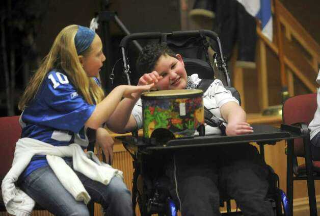 Allyson Jaffe, plays drums with Will Smit, a fifth grader, of Stamford, at the Abilis Family Rock Show for young people of all abilities at the Stamford Jewish Community Center Sunday, Feb. 5, 2012. Photo: Helen Neafsey / Greenwich Time