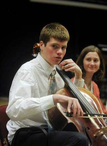 Karl Arezzini, 21, of Greenwich, plays the cello at the Abilis Family Rock Show for young people of all abilities at the Stamford Jewish Community Center Sunday, Feb. 5, 2012. Photo: Helen Neafsey / Greenwich Time