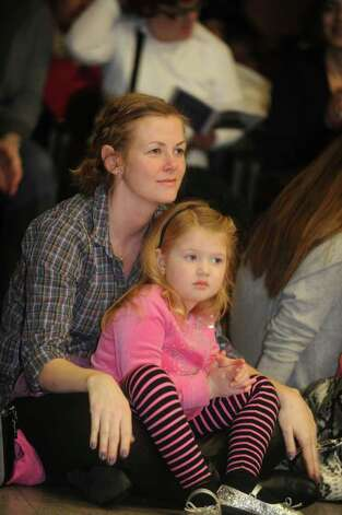Johna English, of Stamford, with her daughter Mya, 3, watches the Abilis Family Rock Show for young people of all abilities at the Stamford Jewish Community Center Sunday, Feb. 5, 2012. Photo: Helen Neafsey / Greenwich Time