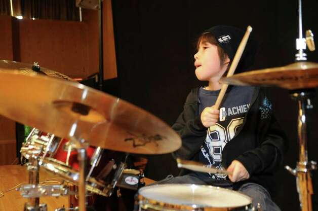 Eli Chen, 10, of Stamford, plays drums for the Swingset Mamas, at the Abilis Family Rock Show for young people of all abilities at the Stamford Jewish Community Center Sunday, Feb. 5, 2012. Photo: Helen Neafsey / Greenwich Time