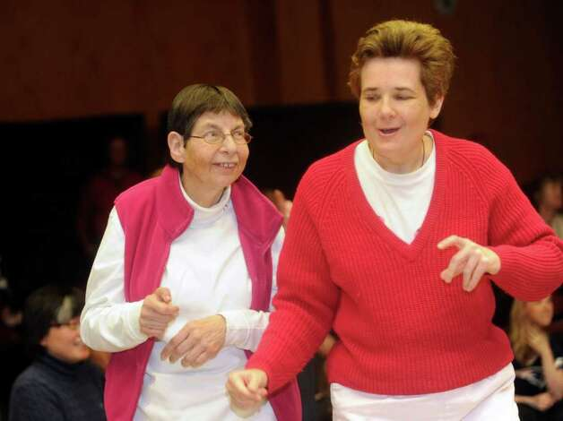Anne Marie Salerno, left, and Barbara Konstandaki, both of Greenwich, dance at the Abilis Family Rock Show for young people of all abilities at the Stamford Jewish Community Center Sunday, Feb. 5, 2012. Photo: Helen Neafsey / Greenwich Time