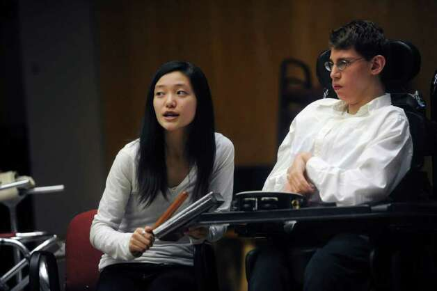 May Hayashida, a senior at Greenwich High School, drums with Joe Edelstein, a senior at GHS at the Abilis Family Rock Show for young people of all abilities at the Stamford Jewish Community Center Sunday, Feb. 5, 2012. Photo: Helen Neafsey / Greenwich Time