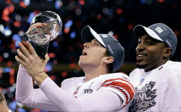 New York Giants kicker Lawrence Tynes holds the Vince Lombardi Trophy after his team's 21-17 win over the New England Patriots in the NFL Super Bowl XLVI football game Sunday, Feb. 5, 2012, in Indianapolis. (AP Photo/David J. Phillip) Photo: David J. Phillip, Associated Press / AP