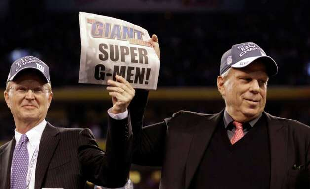 New York Giants Chairman and Executive Vice President Steve Tisch, right, and Co-Owner John Mara celebrate after defeating the New England Patriots 21-17 in the NFL Super Bowl XLVI football game, Sunday, Feb. 5, 2012, in Indianapolis. (AP Photo/David J. Phillip) Photo: David J. Phillip, Associated Press / AP