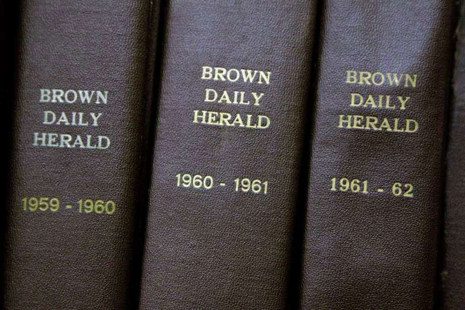 In this Feb. 2, 2012 photo, archived editions of the Brown University Herald used by Brown senior Malcolm Burnley, 22, sit on a shelf at the John Hay Library on campus in Providence, R.I. Burnley discovered a long-lost tape recording of a 1961 address by Malcolm X at Brown while Burnley was combing through archived editions of the Herald conducting research for a nonfiction writing class. (AP Photo/Stephan Savoia) Photo: Stephan Savoia