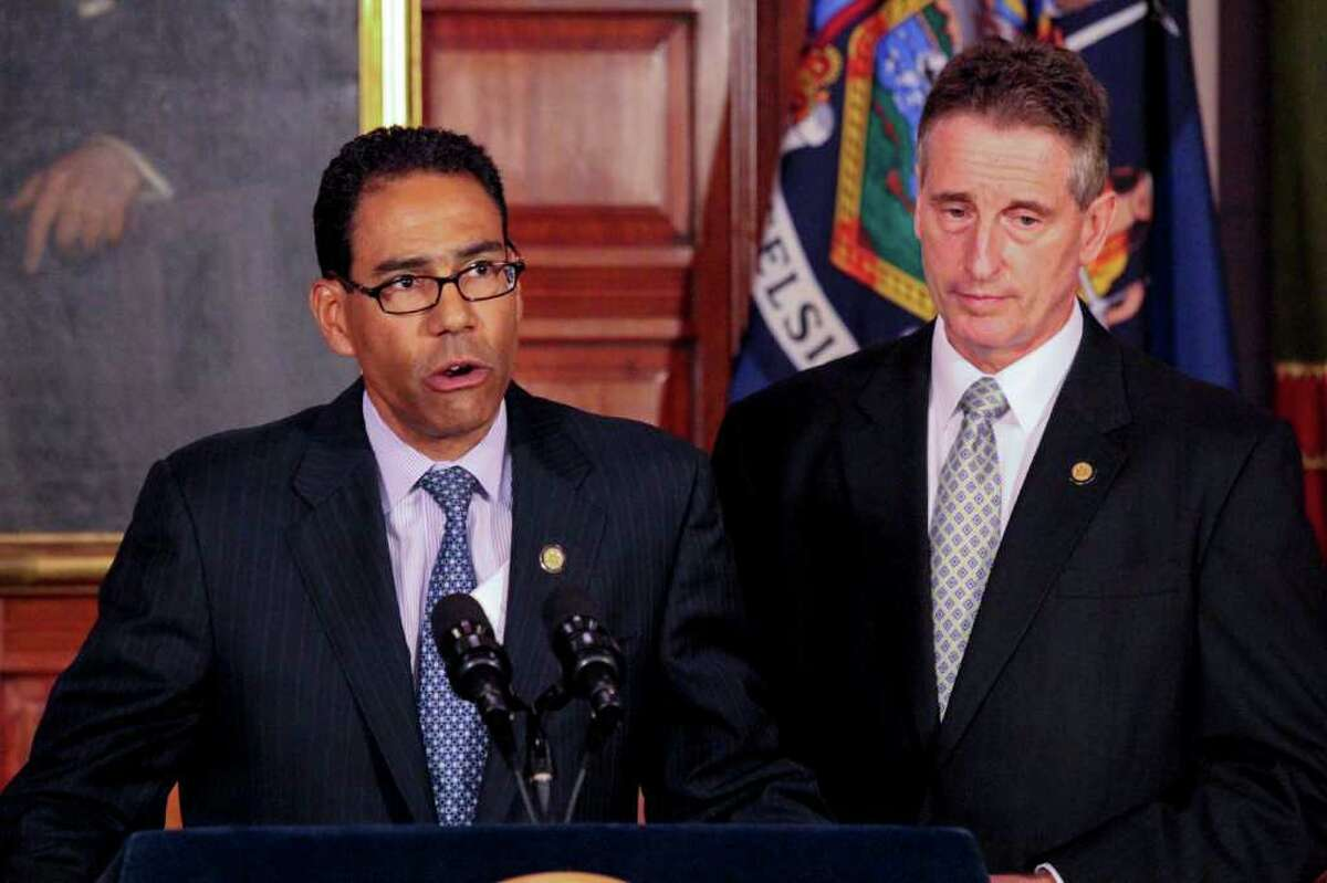 Department of Taxation and Finance Commissioner Thomas Mattox, left, and Lieutenant Governor Robert Duffy, right, speak at the State Capitol on Friday, July 15, 2011 to announce New York State's plan to enfore the collection of unstamped and untaxed tobacco products. New York State estimates that the tax value of the property seized since the efforts began totalled 1.2 million dollars. One source of untaxed tobacco comes from sovereign Native American reservations within the state. (Erin Colligan / Special To The Times Union)