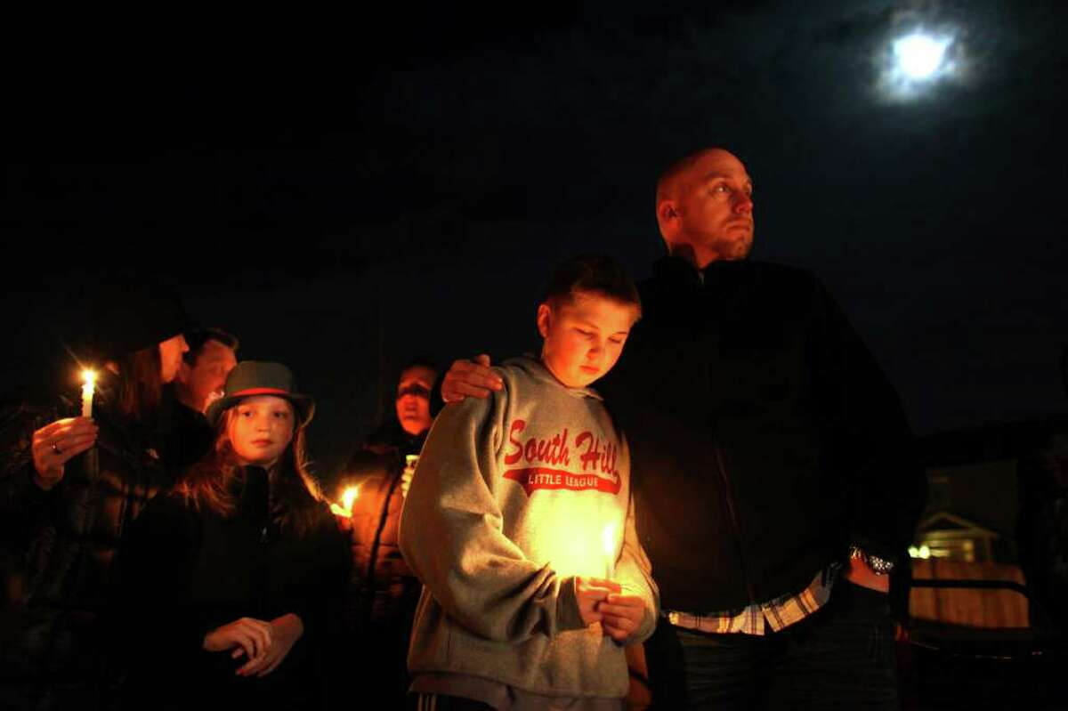Mike Casper embraces his son Brenden Casper, 12, at Carson Elementary School in Puyallup during a vigil at the school. Josh Powell reportedly burned down his house, killing his two sons Charlie and Braden in unincorporated Pierce County on Sunday, February 5, 2012. Casper knew the boys from school.