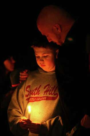 Mike Casper embraces his son Brenden Casper, 12, at Carson Elementary School in Puyallup during a vigil at Carson Elementary School in Puyallup. Josh Powell reportedly burned down his house, killing his two sons Charlie and Braden in unincorporated Pierce County on Sunday, February 5, 2012. Classmates and friends gathered in front of the school for a vigil Sunday night. Photo: JOSHUA TRUJILLO / SEATTLEPI.COM