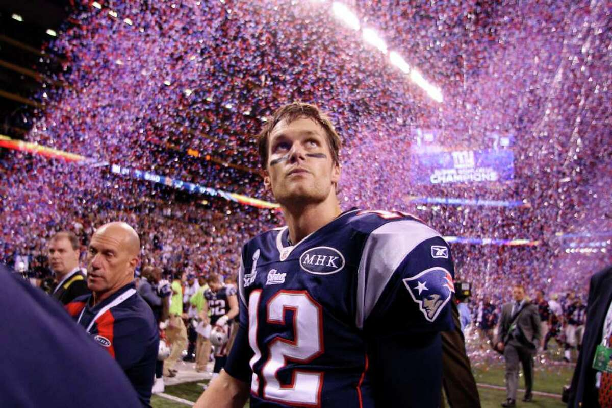Patriots quarterback Tom Brady leaves the field amid a cascade of confetti, celebration and disappointment at Lucas Oil Stadium after the New York Giants denied New England a fourth Super Bowl title. Brady twice has been named Super Bowl MVP, but not this night.