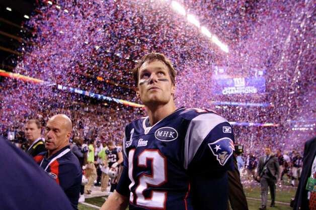 Patriots quarterback Tom Brady leaves the field amid a cascade of confetti, celebration and disappointment at Lucas Oil Stadium after the New York Giants denied New England a fourth Super Bowl title. Brady twice has been named Super Bowl MVP, but not this night. Photo: Elsa / 2012 Getty Images