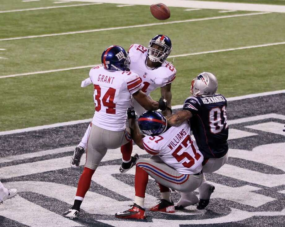 INDIANAPOLIS, IN - FEBRUARY 05:  New York Giants defenders knock down the football from Aaron Hernandez #81 of the New England Patriots in the fourth quarter during the game against the New England Patriots during Super Bowl XLVI at Lucas Oil Stadium on February 5, 2012 in Indianapolis, Indiana.  (Photo by Jeff Gross/Getty Images) Photo: Jeff Gross