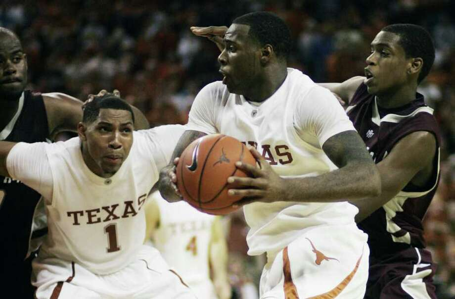 """Jan. 16, 2010, in Austin: UT 72, A&M 67 (OT) -The Longhorns entered the game ranked No. 1, but the Aggies pushed their rival to the limit and then some in UT's extra-frame victory. Damion James, center, blocked B.J. Holmes' 3-point attempt - the Aggies argued Holmes was fouled - to top off the victory. Quotable: """"It was our game. It got away. We couldn't make plays. But the Longhorns are pretty good."""" A&M coach Mark Turgeon. Photo: Harry Cabluck, AP / FR170210 AP"""
