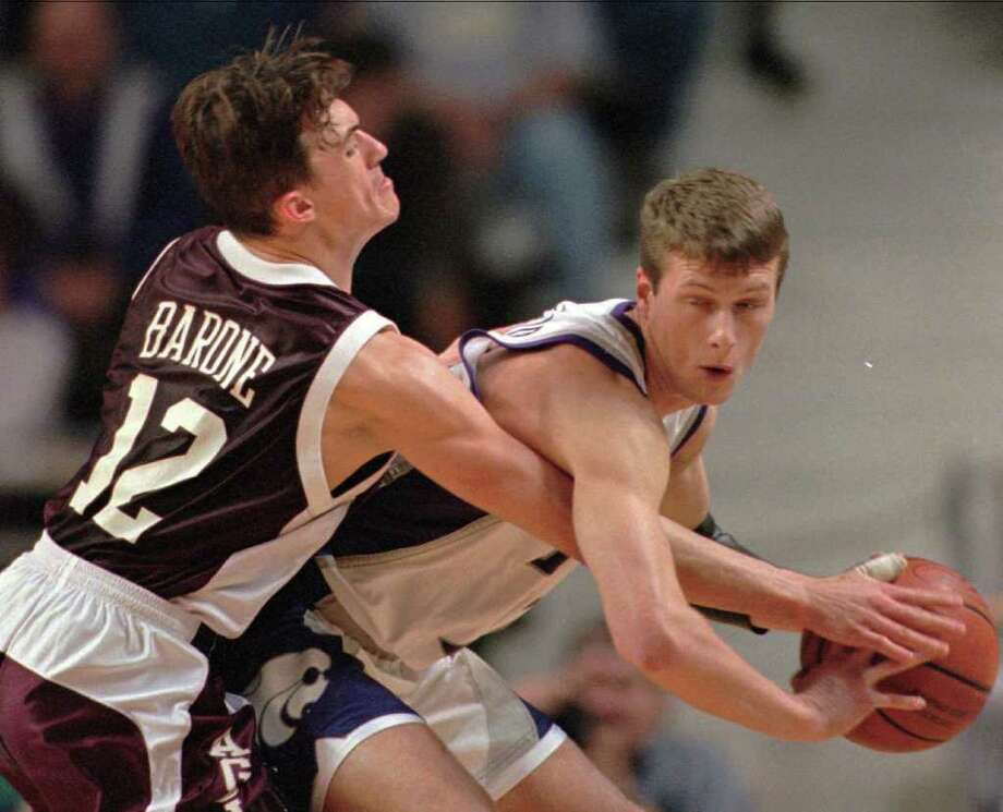 """Jan. 15, 1997, in College Station: UT 86, A&M 76 (OT)- From 1983-96, the rivals played only one game when one of the teams was ranked. In 1997, the Longhorns entered G. Rollie White Coliseum ranked 23rd. The Aggies would've earned an upset had Brian Barone, left, made a jumper at the end of regulation. Quotable: """"It was terrible. So much sweat and dust. A&M pulled out all of the stops, I guess, for a home-court advantage."""" - UT's Reggie Freeman, who scored 30 points, describing G. Rollie's floor. Photo: ORLIN WAGNER, AP / AP"""