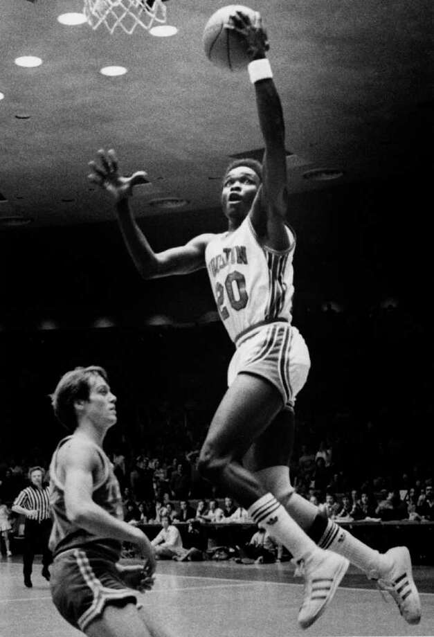 "Jan. 30, 1982, in Austin: A&M 71, UT 69 (OT) - The fifth-ranked Longhorns were without star Mike Wacker, left, and dropped their second straight game that week following Wacker's season-ending knee injury. Claude Riley drained a short jump shot with four seconds remaining to hand unranked A&M the upset. Quotable: ""First thing I do Monday is go out and buy LaSalle (Thompson) a saddle so people won't have to bareback him when they ride him."" - Abe Lemons griping about the ""walloping"" his center took. Photo: Timothy Bullard, Houston Chronicle / Houston Chronicle"