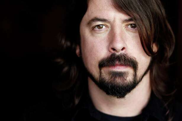 """In this Jan. 31, 2012 photo, musician Dave Grohl poses for a portrait in Los Angeles. The 43-year-old Foo Fighters frontman's band had a top-selling tour, sold more than 663,000 copies of their album """"Wasting Light"""" and were nominated for six Grammys, including album of the year."""