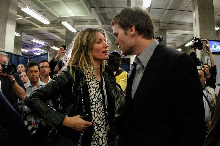 INDIANAPOLIS, IN - FEBRUARY 05:  Tom Brady #12 of the New England Patriots chats with his wife Gisele Bundchen after losing to the New York Giants by a score of 21-17 in Super Bowl XLVI at Lucas Oil Stadium on February 5, 2012 in Indianapolis, Indiana. Photo: Rob Carr, Getty Images / 2012 Getty Images