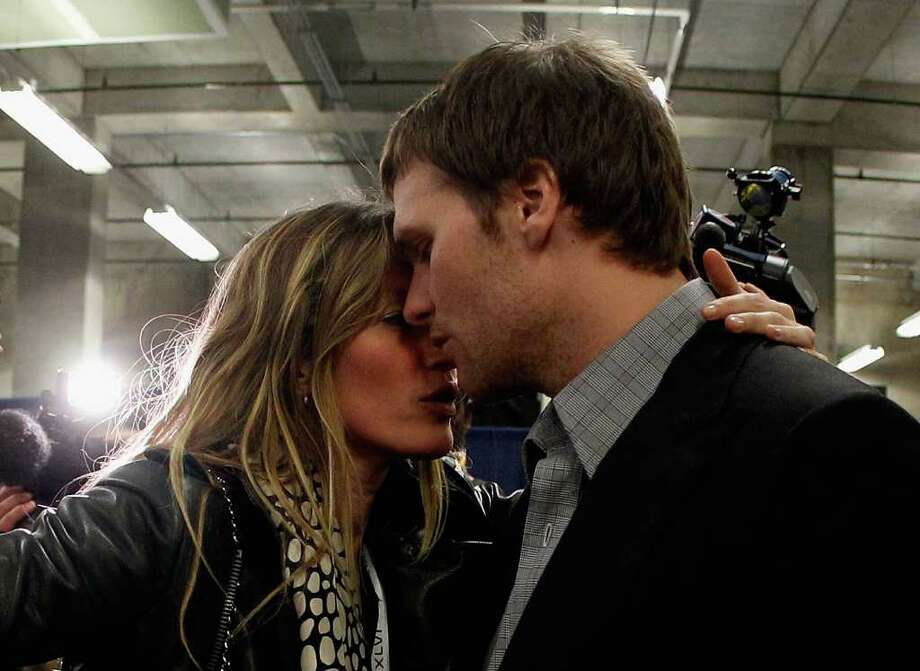 INDIANAPOLIS, IN - FEBRUARY 05:  Tom Brady #12 of the New England Patriots is comforted by his wife Gisele Bundchen after losing to the New York Giants by a score of 21-17 in Super Bowl XLVI at Lucas Oil Stadium on February 5, 2012 in Indianapolis, Indiana. Photo: Rob Carr, Getty Images / 2012 Getty Images