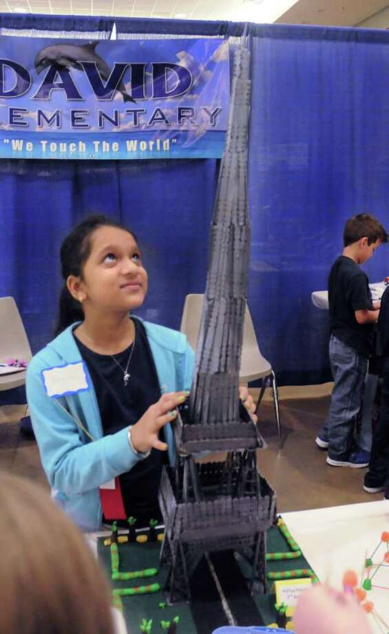 Roshni Prasad shows off the tower she and her classmates made out of popsicle sticks for the David Elementary booth at the 2012 SCI:// Tech Expo, sponsored by the Education for Tomorrow Alliance, at Lone Star Convention Center in Conroe. 3,000 students participated in the Expo, assisted by 300 volunteers.  David Hopper photograph Photo: David Hopper, For The Chronicle / freelance