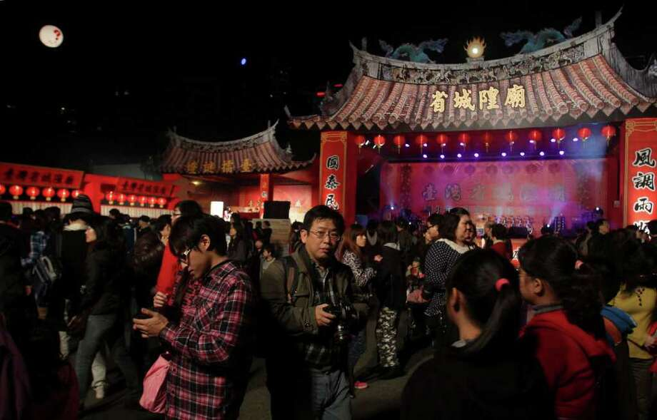 People visit Lantern Festival for the celebration of the end of Chinese Lunar New Year in Taipei, Taiwan, Saturday, Feb. 4, 2012. (AP Photo/Chiang Ying-ying) Photo: Chiang Ying-ying, Associated Press / AP