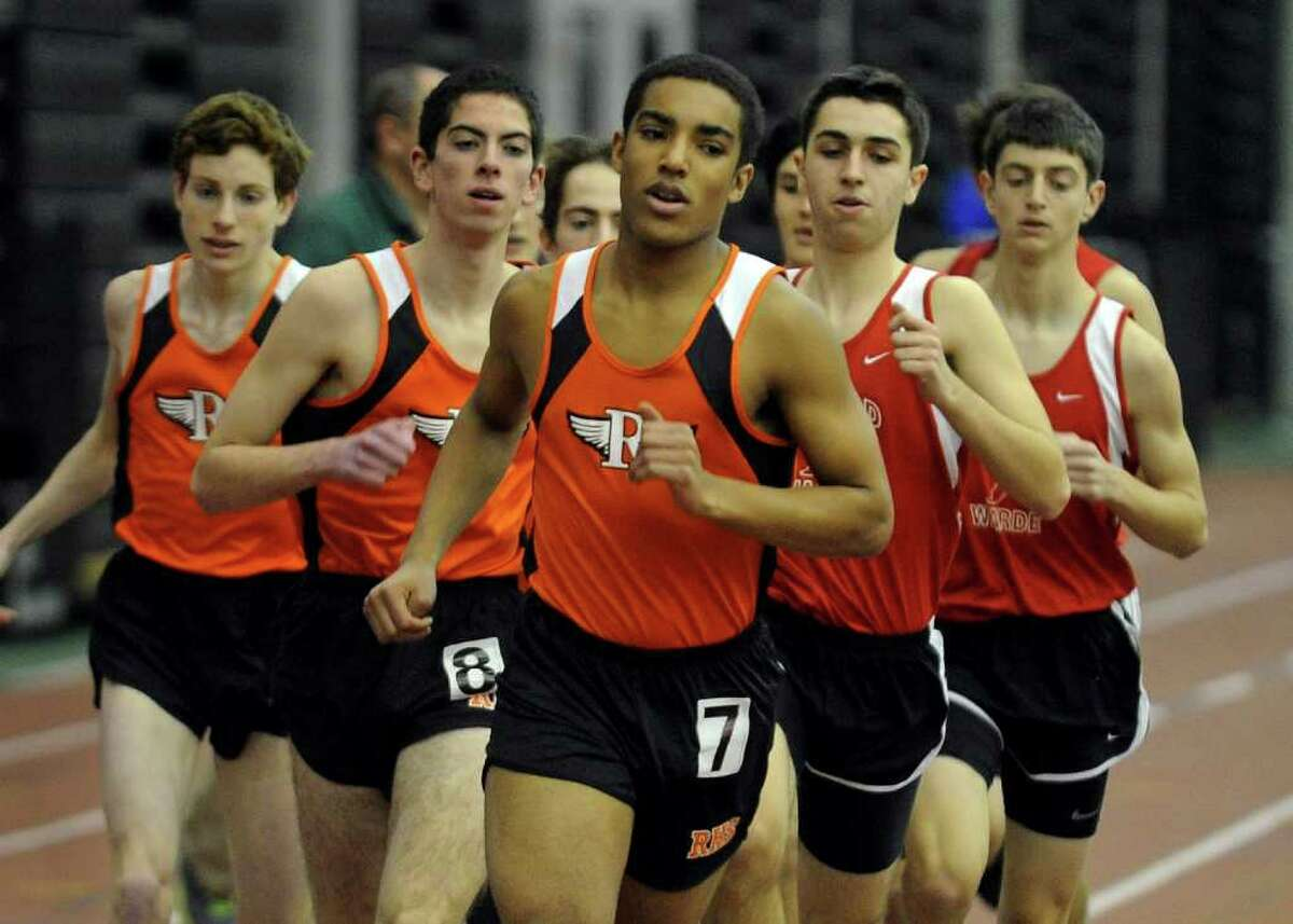 Ridgefield's Graham Hewitt is the front runner in the 1000 meter race, during FCIAC Track Championship action at the New Haven Athletic Center in New Haven, Conn. on Thursday February 2, 2012.