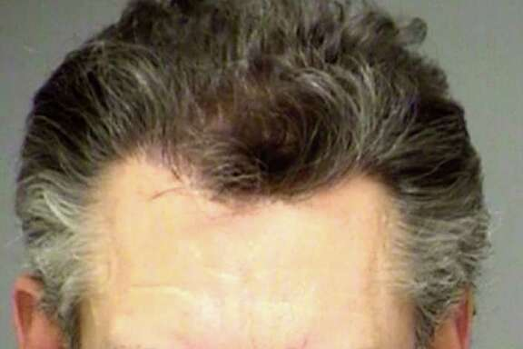 This Feb. 6, 2012 booking photo provided by the Denton County Sheriff's Department in Texas, shows country music star Randy Travis. Travis was arrested in Sanger, Texas, on Monday, Feb. 6, 2012, on a charge of public intoxication.  (AP Photo/Denton County Sheriff's Department)