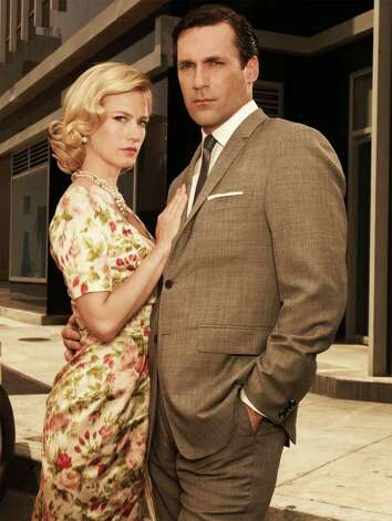 "January Jones (as Betty Draper) and Jon Hamm (as Don Draper) star in ""Mad Men"". Photo: AMC / AMC"