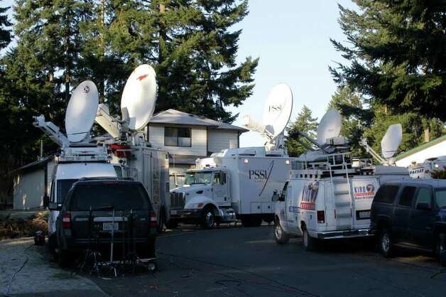 Television trucks crowd a narrow suburban street, Monday, Feb. 6, 2012, near the home where Josh Powell and his two sons were killed Sunday, in Graham, Wash., Monday, Feb. 6, 2012,. Powell's wife Susan went mysteriously missing from their West Valley City, Utah, home in December 2009. Photo: AP