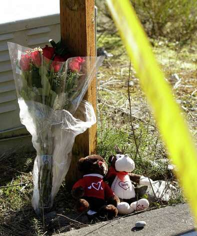 Flowers and two stuffed animals are left near crime-scene tape, Monday, Feb. 6, 2012, near the home where Josh Powell and his two sons were killed Sunday, in Graham, Wash., in what police said appeared to be a deliberately set fire. Powell's wife Susan went mysteriously missing from their West Valley City, Utah, home in December 2009. Photo: AP