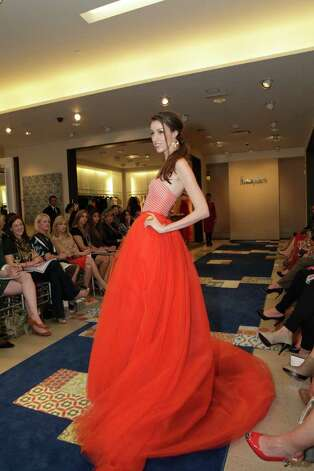 A model wears a neon-colored evening gown from Christian Siriano's spring 2012 collection during a benefit show for the Texas Biomedical Forum held at Neiman Marcus at the Shops at La Cantera. Photo: ;, Photo Courtesy Jeffrey Truitt  / Jeffrey Truitt Photography for Neiman Marcus