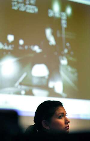 Jenny Ybarra views a video of herself taking the sobriety field test at the scene of the accident she was in. Ybarra is on trial for the intoxication manslaughter of Erica Nicole Smith in the 437th District Court at the Cadena Reeves Justice Center. Photo: Bob Owen, San Antonio Express-News / © 2012 San Antonio Express-News