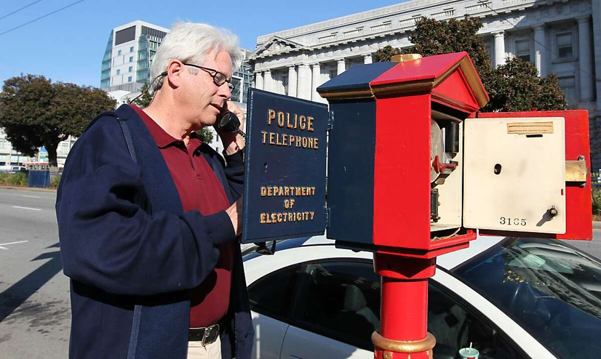 Jack Donohoe from the San Francisco Department of Technology talks to a police dispatcher using the police call box on Van Ness Street. Both Police and fireboxes are dated to the late 1800?•s but the Police box phone is modern and was used when most cell phone communications were down during the Loma Prieta Earthquake of 1989. For over a century, blue and red metal police and fire call boxes have dotted San Francisco's landscape. Friday February 3, 2012.
