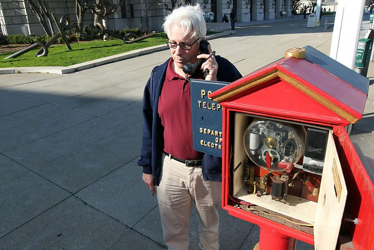 Jack Donohoe from the San Francisco Department of Technology talks to a police dispatcher using the police call box on Van Ness Street. Both Police and fireboxes are dated in the late 1800?•s but the Police box phone is modern and was used when most cell phone communications were down during the Loma Prieta Earthquake of 1989. For over a century, blue and red metal police and fire call boxes have dotted San Francisco's landscape. Friday February 3, 2012.