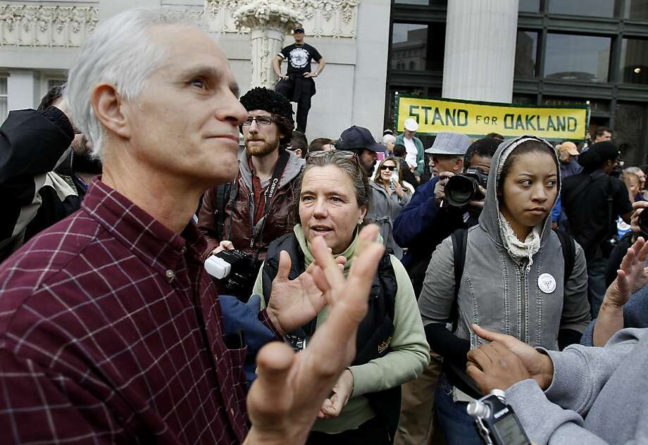 Ken Woolfe (left) became exasperated talking with Occupy members in front of City Hall. A rally by a group of people angered by the Occupy Oakland movement was joined by Occupy Oakland members and became confrontational.  The Oakland Police also confiscated some audio equipment used by the movement in front of Oakland City Hall. Photo: Brant Ward, The Chronicle
