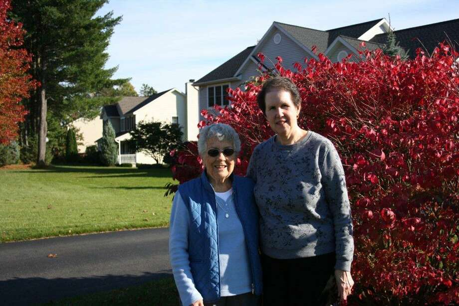 Evelyn Lanzo of Clifton Park, left, receives care from Joan Lambert, a volunteer with Care Links. Photo provided by Care Links.