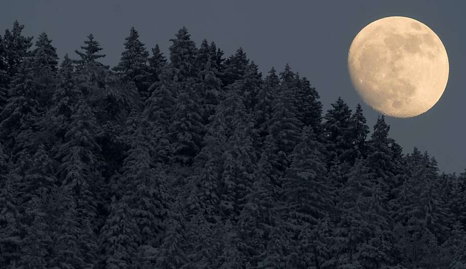 A big ol' moon rises over snow-covered trees near Garmisch-Partenkirchen, Germany. Photo: Johannes Eisele, AFP/Getty Images